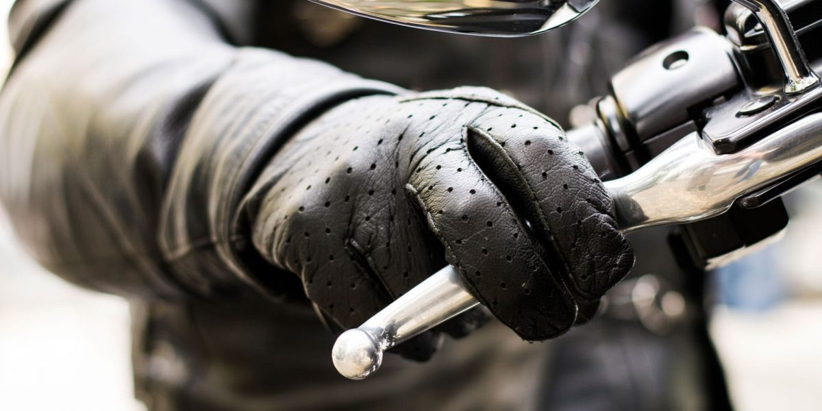 Close up of a hand gripping a motorcycle throttle